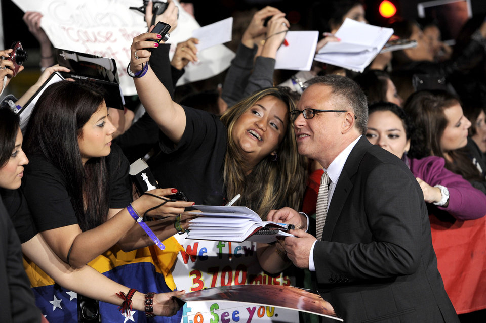 Photo - Director Bill Condon arrives at the world premiere of