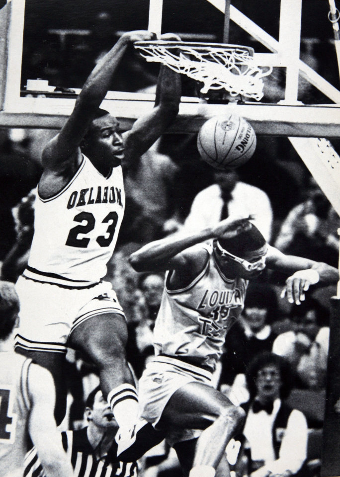 Photo - Former OU basketball player Wayman Tisdale. DALLAS, March 21-TISDALE STUFFS--Oklahoma center Wayman (23) jams for a tally during action in Dallas Thursday night. Louisiana Tech. center Willie Simmons ducks under the action. Photo by Doug Hoke. Photo taken 3/21/1985, photo published 3/22/1985 in The Daily Oklahoman. ORG XMIT: KOD