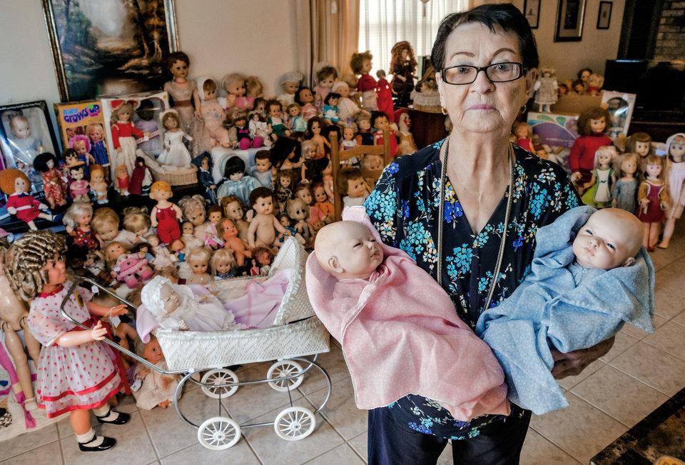 Photo -  Imogene McDowell, 93, has amassed an extensive doll collection over the years. As she moves from her home in Mustang into a smaller place to live, the dolls need new digs.  [Photo by Chris Landsberger, The Oklahoman]