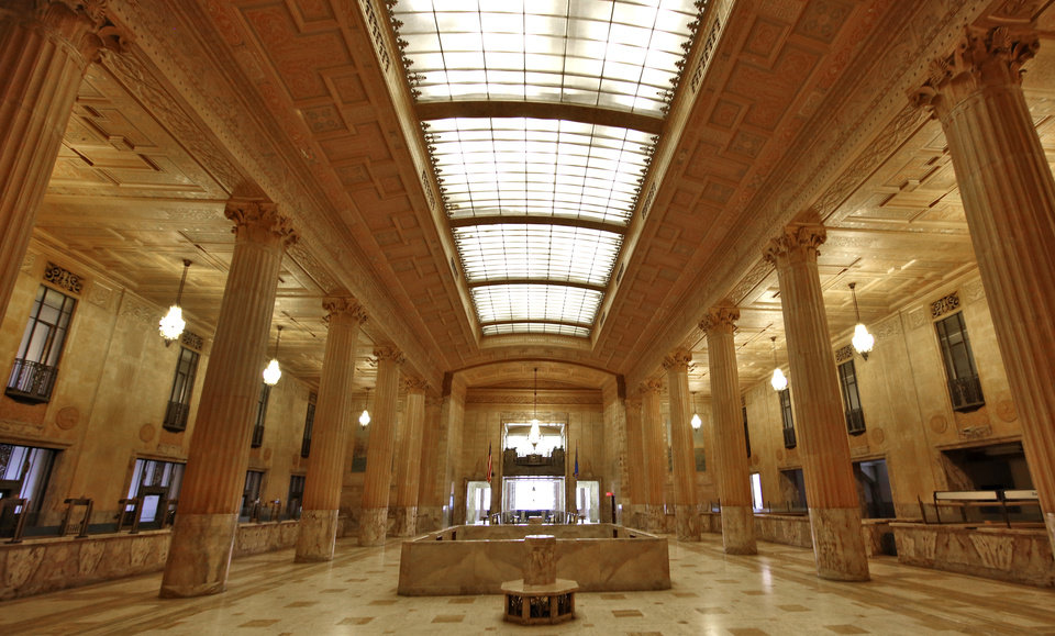 Photo -  The redevelopment includes plans to restore the Great Banking Hall at the downtown landmark to its former glory. [Photo by Steve Gooch, The Oklahoman]