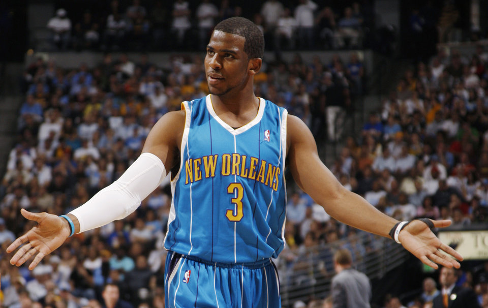 c77102b11 New Orleans Hornets guard Chris Paul looks for a call from the officials as  the Hornets play the Denver Nuggets in the first quarter of Game 5 in an  NBA ...