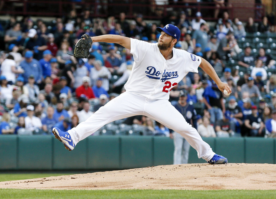 Photo - Clayton Kershaw pitches for Oklahoma City in the first inning during a minor league baseball game between the San Antonio Missions and the Oklahoma City Dodgers at the Chickasaw Bricktown Ballpark in Oklahoma City, Thursday, April 4, 2019. Kershaw pitched four and a third innings in the rehab start. Photo by Nate Billings, The Oklahoman