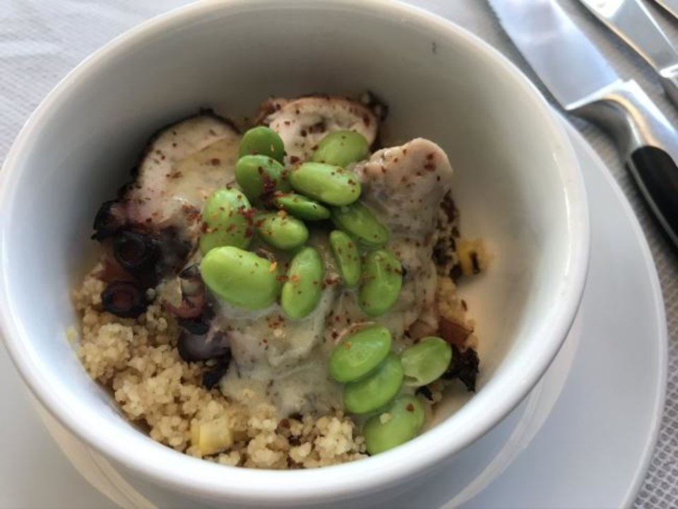 Photo -  Grilled Octopus with couscous, bacon and lime butter started things at an August wine dinner at Vast in Oklahoma City. [Dave Cathey/The Oklahoman]