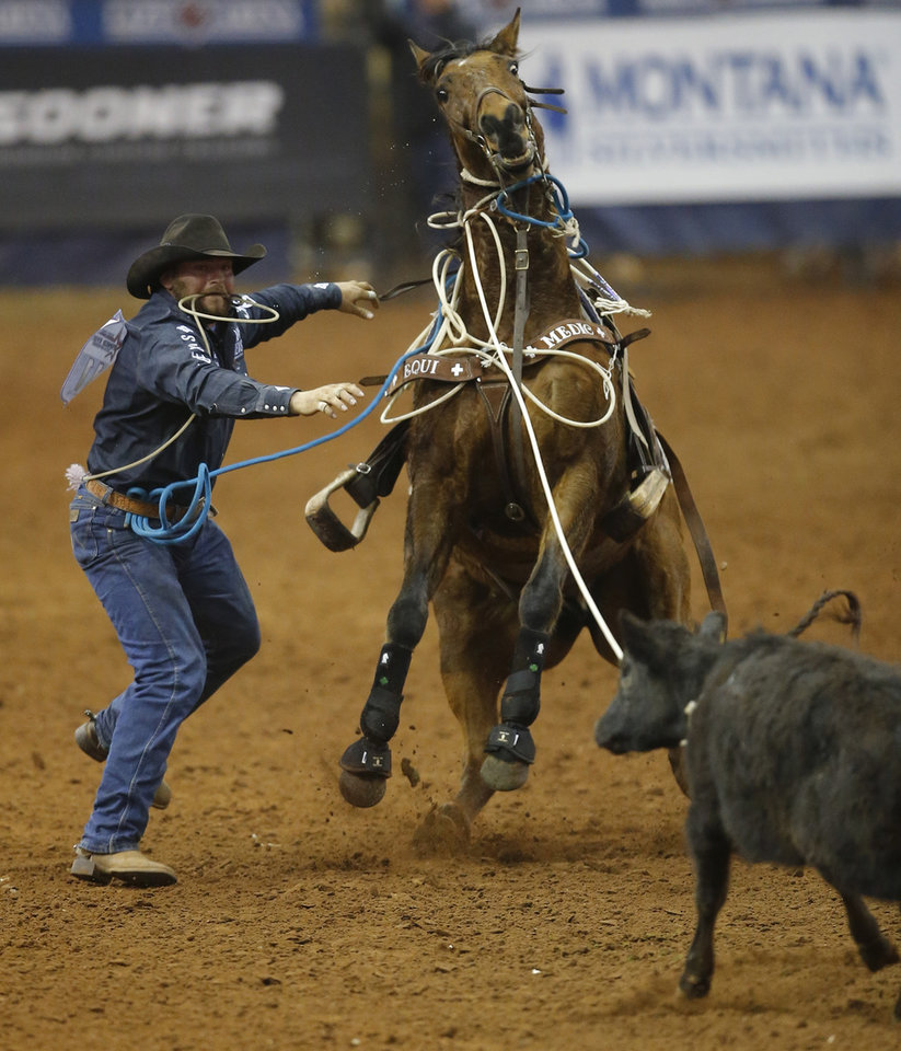 Photo - Jace Melvin of Ft. Pierre, South Dakota,  competes in the tie-down roping event during the Timed Event Championship inside the Lazy E Arena in Guthrie, Okla., Friday, March 13, 2020. [Bryan Terry/The Oklahoman]