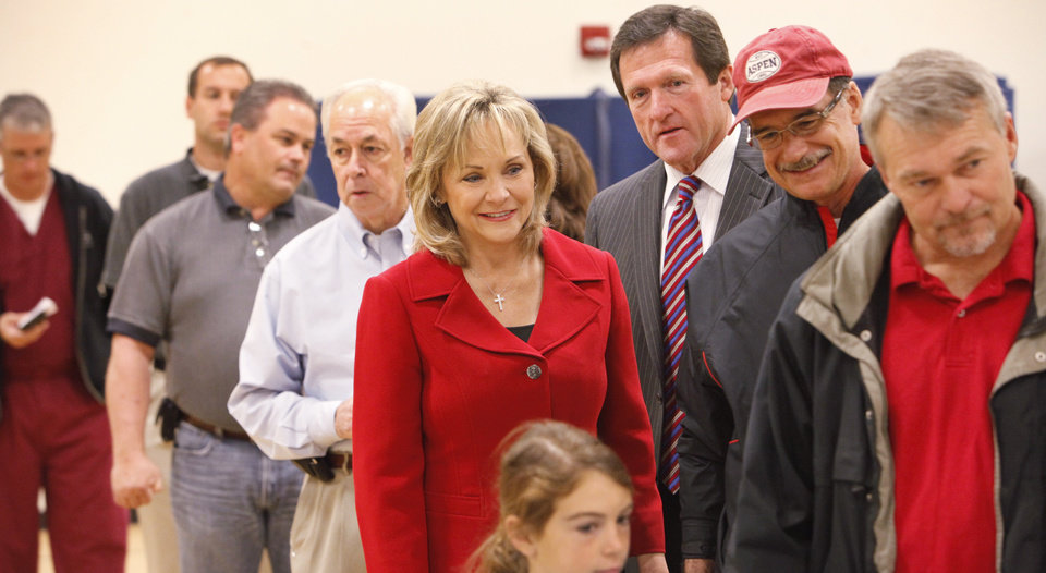 Photo - Mary Fallin waits in a line to vote at Deer Creek Middle School, Tuesday,  November 2, 2010.   Staff photo by David McDaniel, The Oklahoman