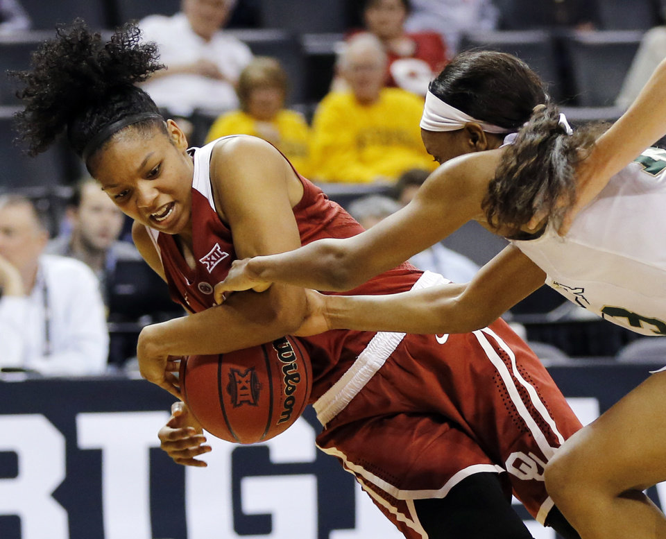 Photo - Oklahoma's Gioya Carter (25) and Baylor's Nina Davis (13) fight for the ball during a semifinal game in the Big 12 Women's Basketball Championship between the Oklahoma Sooners (OU) and the Baylor Lady Bears at Chesapeake Energy Arena in Oklahoma City, Sunday, March 6, 2016. Photo by Nate Billings, The Oklahoman