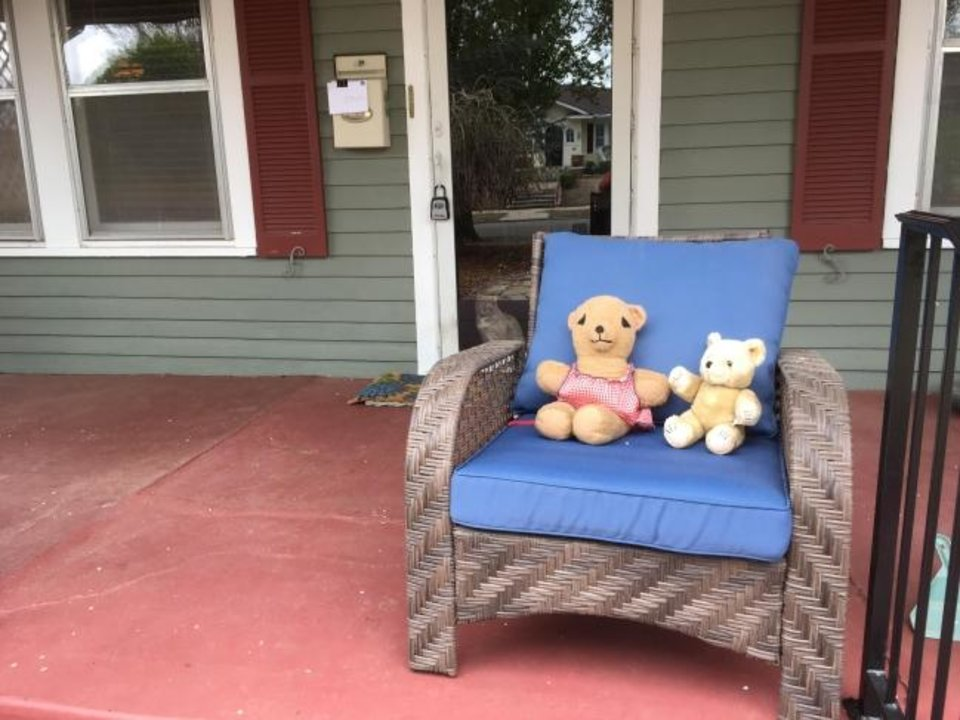 Photo -  Bears hang out on the porch of this house in Gatewood. Many houses are displaying bears to set up something for younger children to discover as they go for walks. [CAROLYN WADE/PROVIDED]