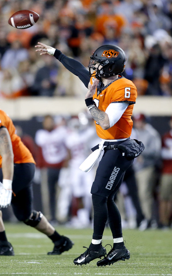 Photo - Oklahoma State's Dru Brown (6) throws the ball in the second quarter during the Bedlam college football game between the Oklahoma State Cowboys (OSU) and Oklahoma Sooners (OU) at Boone Pickens Stadium in Stillwater, Okla., Saturday, Nov. 30, 2019. OU won  34-16. [Sarah Phipps/The Oklahoman]