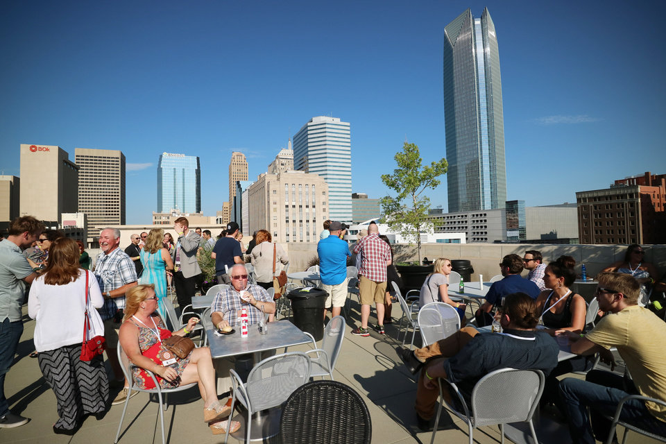 Photo -  People mingle during the deadCenter rooftop party at Oklahoma City Museum of Art  on June 11. [Photo by Doug Hoke, The Oklahoman]