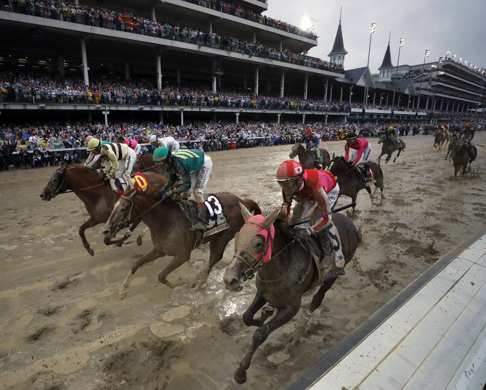 Photo - Flavien Prat ride Country House, left, to the finish line during the 145th running of the Kentucky Derby horse race at Churchill Downs Saturday, May 4, 2019, in Louisville, Ky. Country House was declared the winner after Maximum Security was disqualified following a review by race stewards. (AP Photo/Matt Slocum)