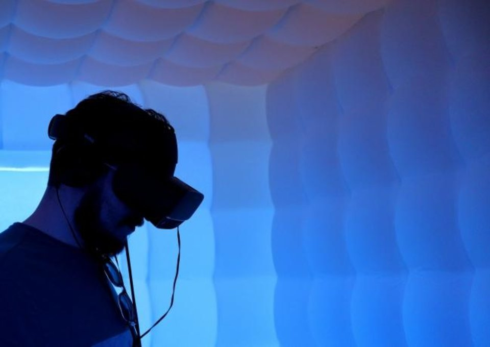 Photo -  Taylor Adams experiences Gloomy Eyes in VR on Saturday at the techCenter in 21c Museum Hotel during deadCenter Film Festival. [Doug Hoke/The Oklahoman]