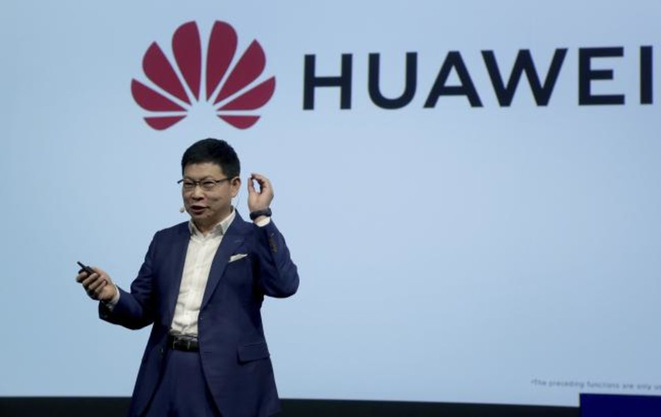 Photo -  Richard Yu, CEO of the Huawei consumer business group, on Friday holds a Kirin 990 5G processor during a keynote at the IFA 2019 tech fair in Berlin, Germany. [AP PHOTO]