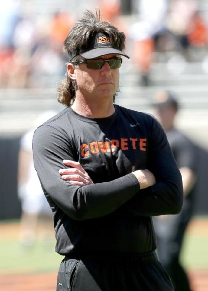 Photo -  Oklahoma State head coach Mike Gundy has left open the possibility of his son Gunnar playing at OSU as a walk-on next year, but no decision has been made.  [Sarah Phipps/The Oklahoman]