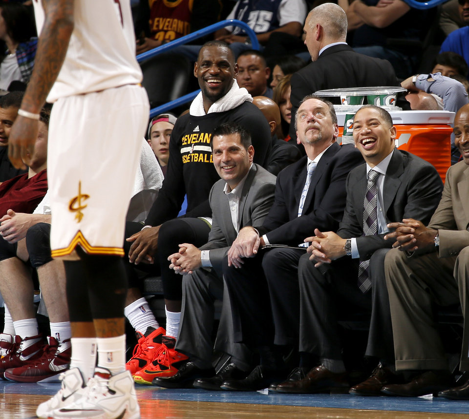 Photo - Cleveland coach Yronn Lue, right, and Lebron James laugh during the second half of an NBA basketball game between the Oklahoma City Thunder and the Cleveland Cavaliers at Chesapeake Energy Arena in Oklahoma City, Sunday, Feb. 21, 2016. Oklahoma City lost 115-92.  Photo by Bryan Terry, The Oklahoman