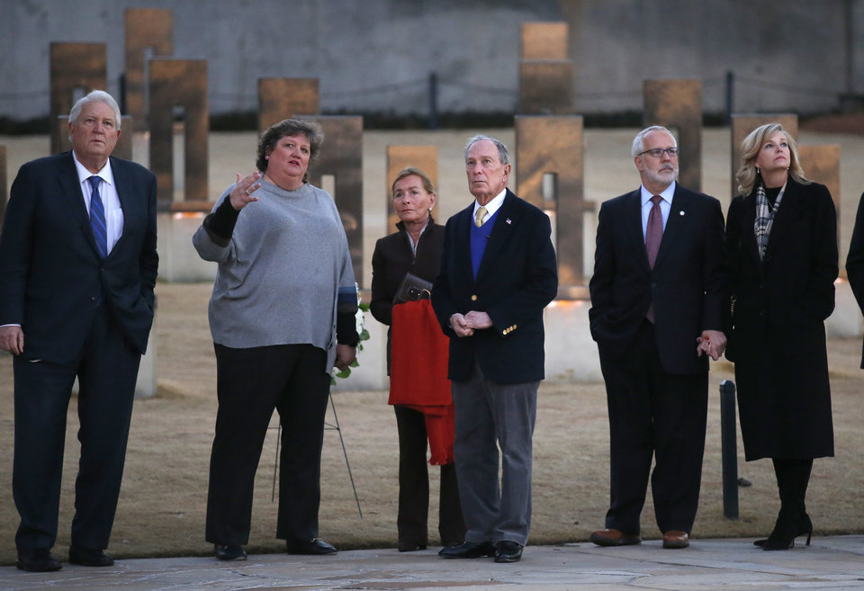 Photo - Oklahoma City National Memorial and Museum Executive Director Kari Watkins talks with Democratic presidential candidate and former New York City Mayor Michael Bloomberg and Judge Judy Sheindlin, center, at the memorial, Saturday, Feb. 8, 2020. Also pictured are Mike Turpen, left, and former governor Brad Henri and his wife.  [Sarah Phipps/The Oklahoman]