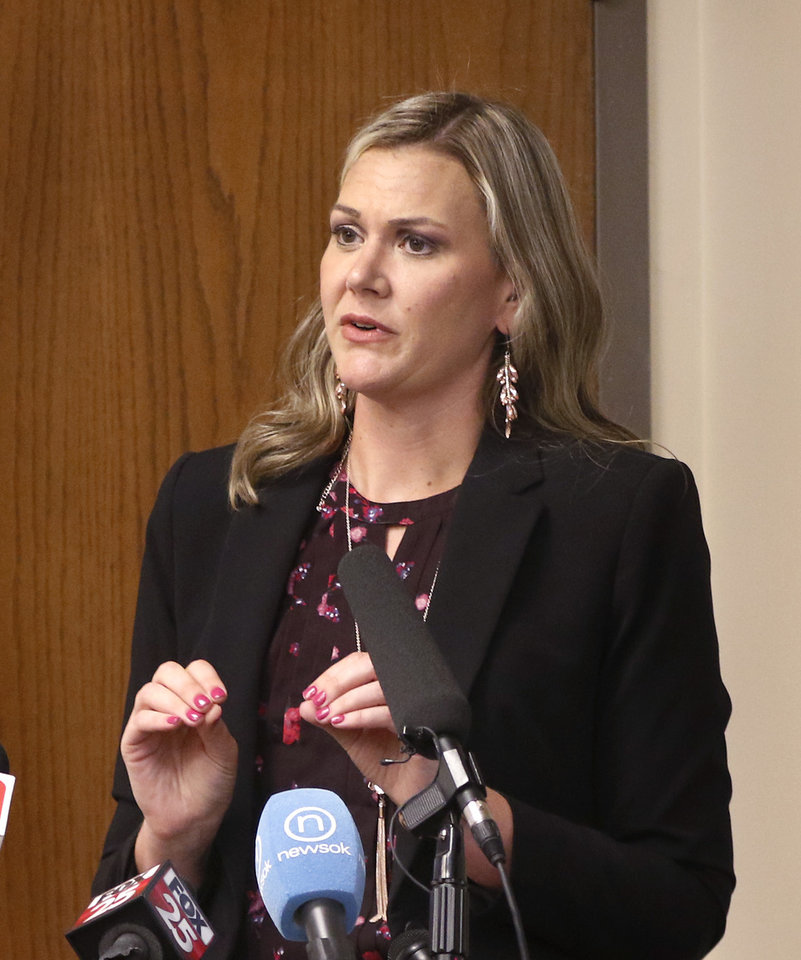 Photo - Julie Ezell, pictured here at a meeting on July 10, 2018,  was accused Tuesday in a criminal charge of sending threats to herself, falsely reporting a crime and preparing false evidence. Ezell, 37, confessed on Friday to creating a false email account and sending the threats to her government email, an Oklahoma State Bureau of Investigation special agent reported in an affidavit. The email account purported to be from a sender concerned about Health Department rules regarding medical marijuana. She was charged with two felonies and a misdemeanor in Oklahoma County District Court.  Ezell,  general counsel for the health department, explains proposed regulations to Department of Health Board members during  their monthly meeting onTuesday morning, July 10, 2018,  when they voted to ban sales of smokeable forms of medical marijuana and to require dispensaries to hire a pharmacist. Photo by Jim Beckel, The Oklahoman