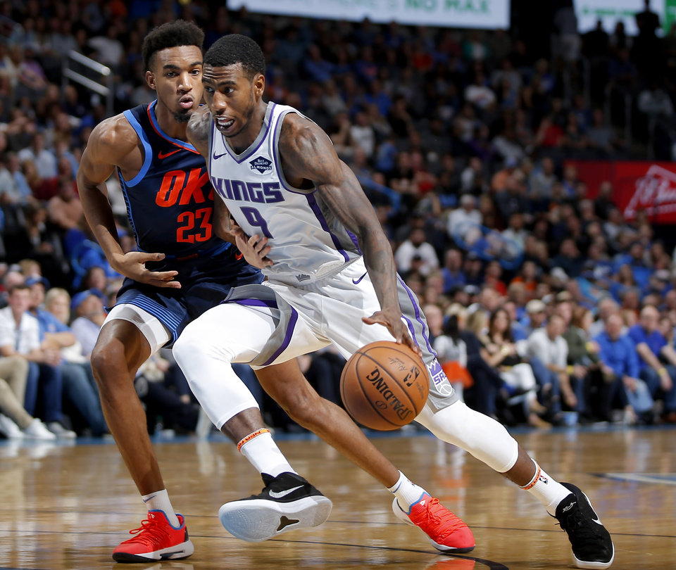 Photo - Sacramento's Iman Shumpert (9) goes past Oklahoma City's Terrance Ferguson (23) during an NBA basketball game between the Oklahoma City Thunder and the Sacramento Kings at Chesapeake Energy Arena in Oklahoma City, Sunday, Oct. 21, 2018. Photo by Bryan Terry, The Oklahoman