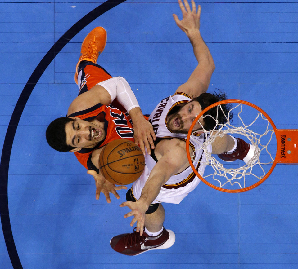Photo - Oklahoma City's Enes Kanter (11) goes to the basket in front of Cleveland's Kevin Love (0) during an NBA basketball game between the Oklahoma City Thunder and the Cleveland Cavaliers at Chesapeake Energy Arena in Oklahoma City, Sunday, Feb. 21, 2016. Oklahoma City lost 115-92.  Photo by Bryan Terry, The Oklahoman