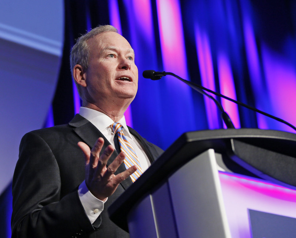 Photo - Mayor Mick Cornett gives his annual state of the city speech during the Greater Oklahoma City Chamber's State of the City Luncheon at the Cox Convention Center in Oklahoma City, Wednesday, Jan. 11, 2017. Photo by Nate Billings, The Oklahoman