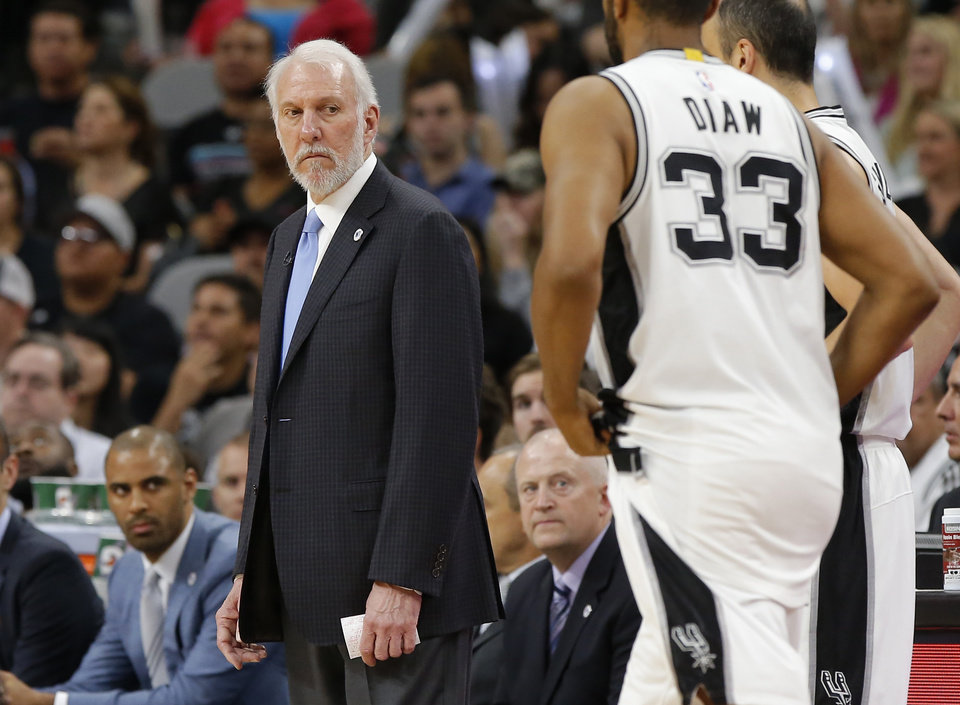 Photo - San Antonio coach Gregg Popovich looks towards San Antonio's Boris Diaw (33) and Manu Ginobili (20) during Game 5 of the second-round series between the Oklahoma City Thunder and the San Antonio Spurs in the NBA playoffs at the AT&T Center in San Antonio, Tuesday, May 10, 2016. Oklahoma City won 95-91. Photo by Bryan Terry, The Oklahoman