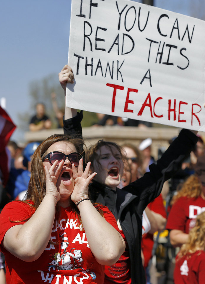 Photo - Tulsa Memorial High School teacher Shawna Mott-Wright makes her voice heard with fellow educators during a rally to appeal to lawmakers to make education funding a priority at the state capitol in Oklahoma City, Okla. on Monday, March 31, 2014. Educators, parents and community members from across Oklahoma gathered at the statehouse to make their voices heard by lawmakers. Photo by Jim Beckel, The Oklahoman