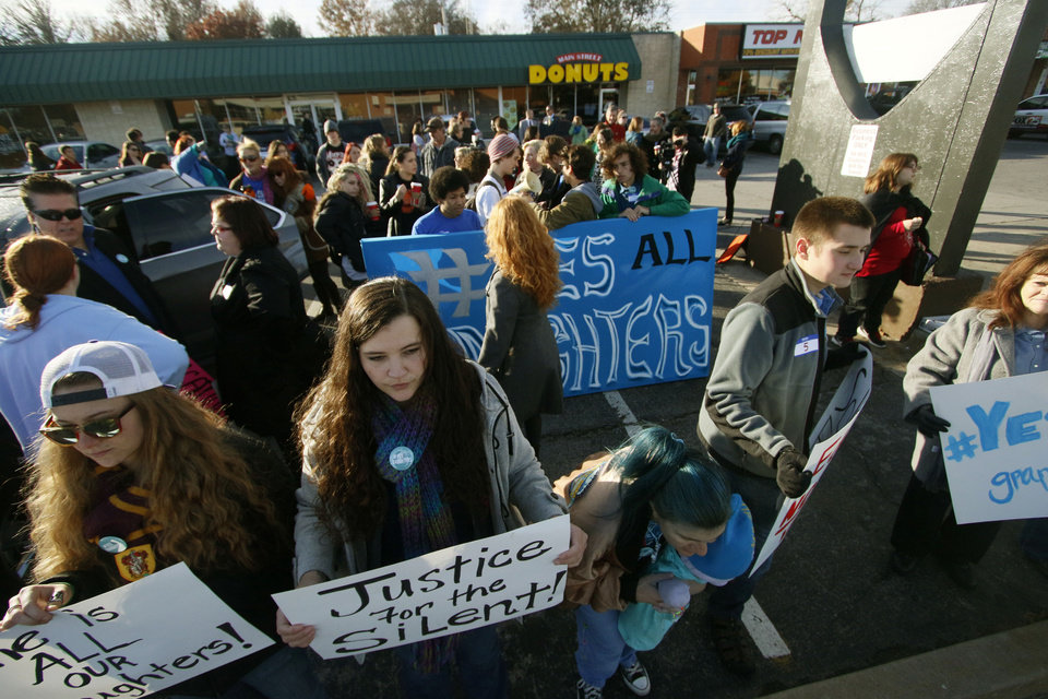 Photo - Norman High School students hold signs before a student-planned walkout to protest bullying and the treatment of sexual assault victims at Norman High School in Norman, OK, Monday, November 24, 2014,  Photo by Paul Hellstern, The Oklahoman