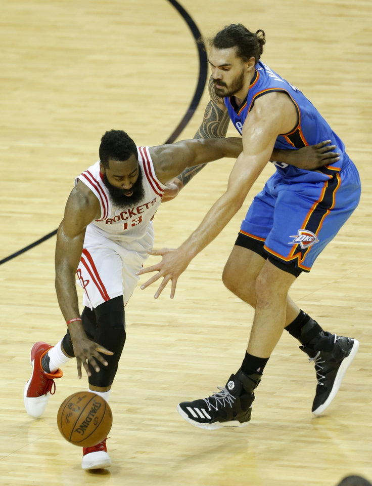 Photo - Oklahoma City's Steven Adams (12) defends against Houston's James Harden (13) during Game 2 in the first round of the NBA playoffs between the Oklahoma City Thunder and the Houston Rockets in Houston, Texas,  Wednesday, April 19, 2017.  Photo by Sarah Phipps, The Oklahoman