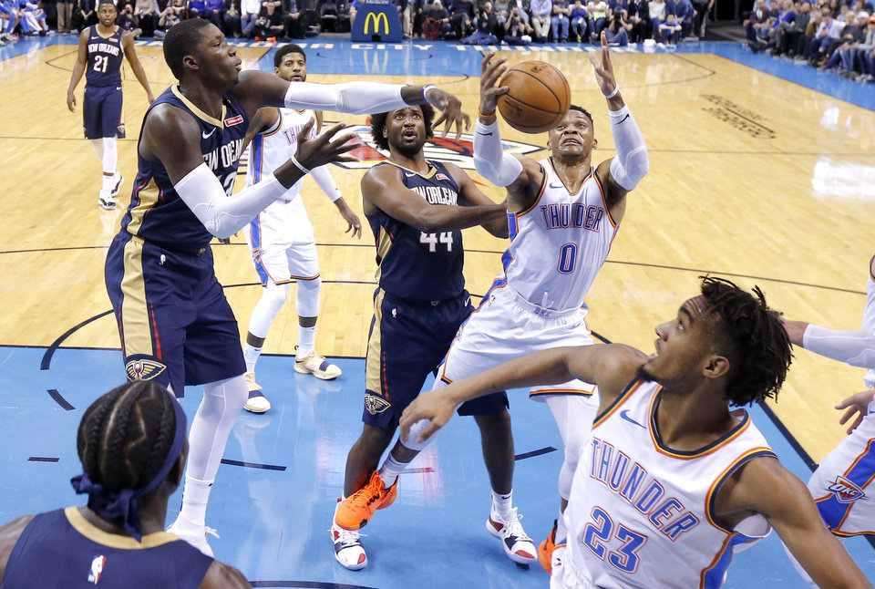 Photo - Oklahoma City's Russell Westbrook (0) goes for a rebound beside New Orleans' Solomon Hill (44) during an NBA basketball game between the Oklahoma City Thunder and the New Orleans Pelicans at Chesapeake Energy Arena in Oklahoma City, Thursday, Jan. 24, 2019. Photo by Bryan Terry, The Oklahoman