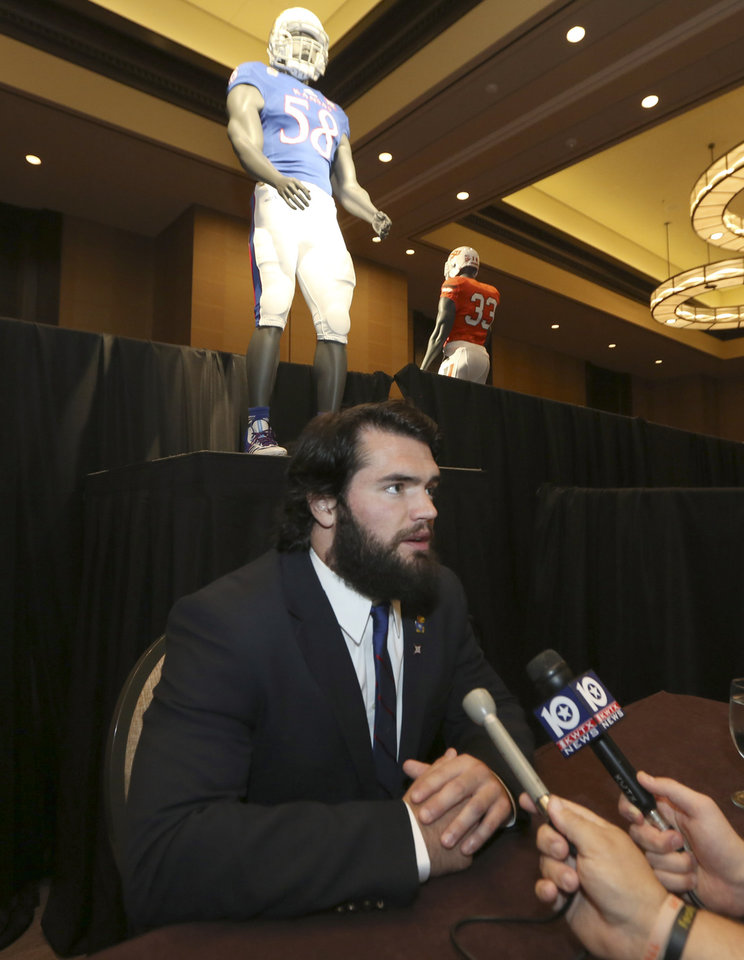 Photo - Kansas linebacker Ben Heeney speaks to a reporter during the NCAA college Big 12 Conference football media days in Dallas, Monday, July 21, 2014. (AP Photo/LM Otero)