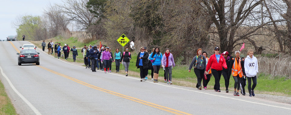 Photo - Teachers walk to Turk's Country store to rest during the March for Public Education by Tulsa teachers, students and supporters, who are walking to the Capitol from Tulsa along SH 66, Sunday, April 8, 2018. Photo by Doug Hoke, The Oklahoman