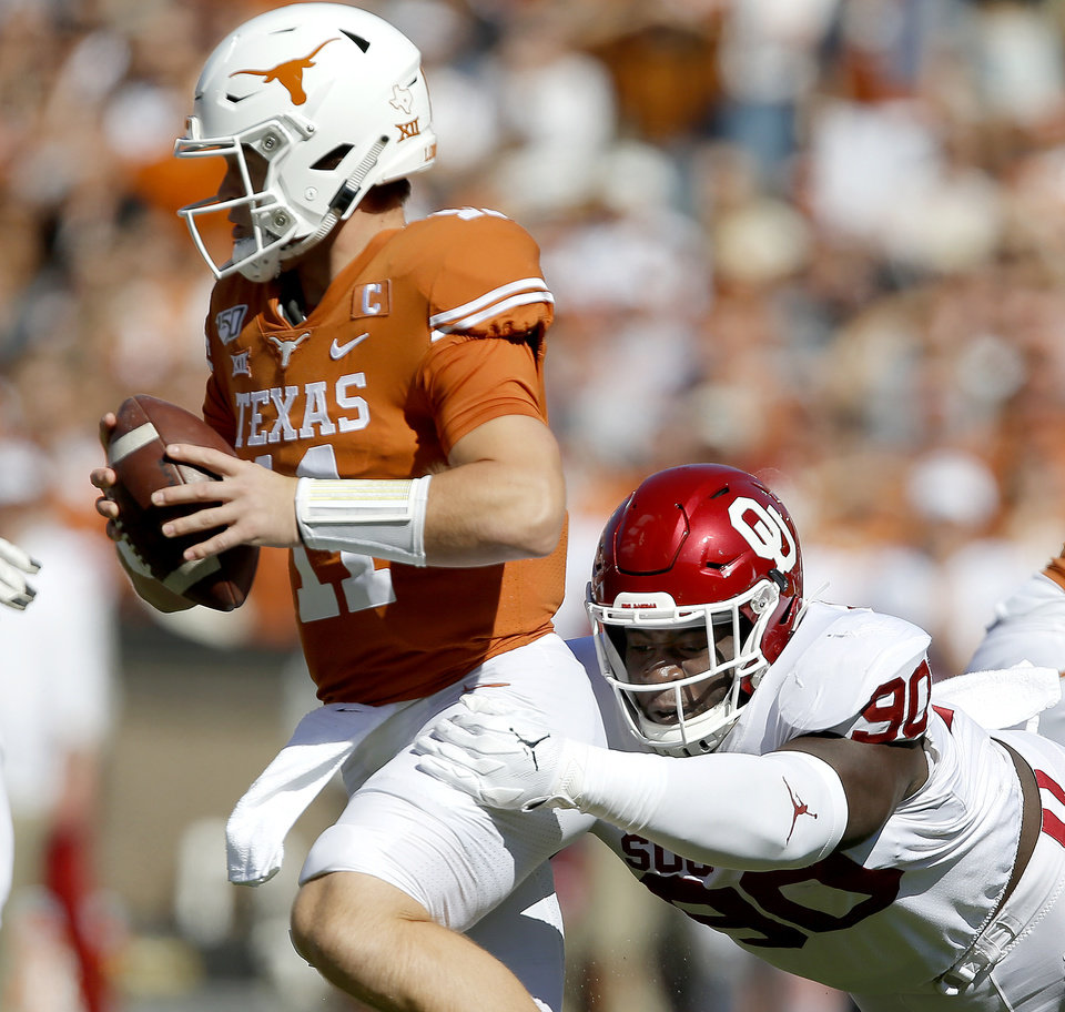 Photo - Oklahoma defensive lineman Neville Gallimore (90) brings down Texas quarterback Sam Ehlinger (11) during the Red River Showdown college football game between the University of Oklahoma Sooners (OU) and the Texas Longhorns (UT) at Cotton Bowl Stadium in Dallas, Saturday, Oct. 12, 2019. Oklahoma won 34-27. [Bryan Terry/The Oklahoman]