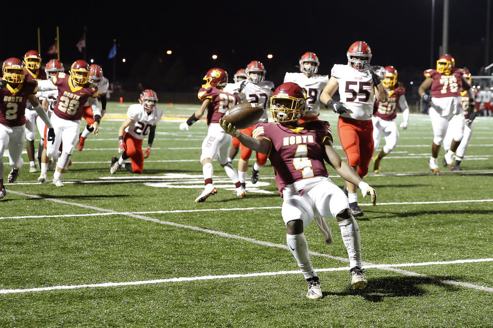 Photo - Putnam City North's KiShaun Denton scores a touchdown during a high school football game between Putnam City North and Mustang in Oklahoma City, Friday, Nov. 1, 2019.  [Bryan Terry/The Oklahoman]