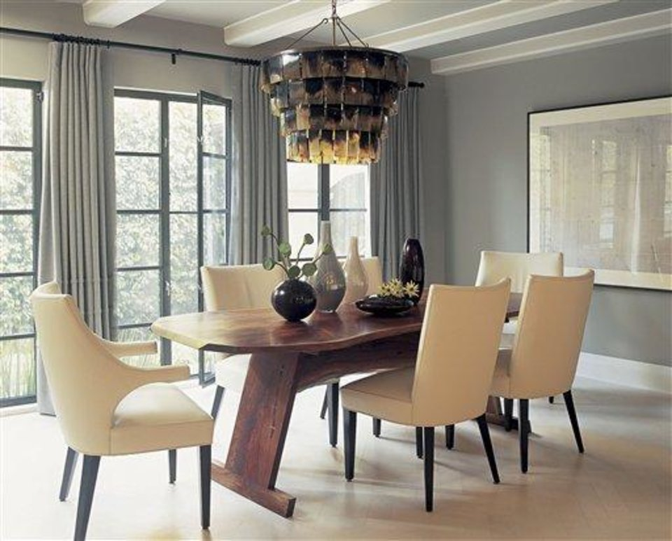 Photo - This undated photo courtesy of Betsy Burnham shows a dining room designed by Betsy Burnham. As comfort has become a priority, pretty but unforgiving chairs are definitely out. Burnham advises testing out new dining chairs before you buy them, since you want your table to be a place where people will enjoy lingering for hours.   (AP Photo/Betsy Burnham)  NO SALES