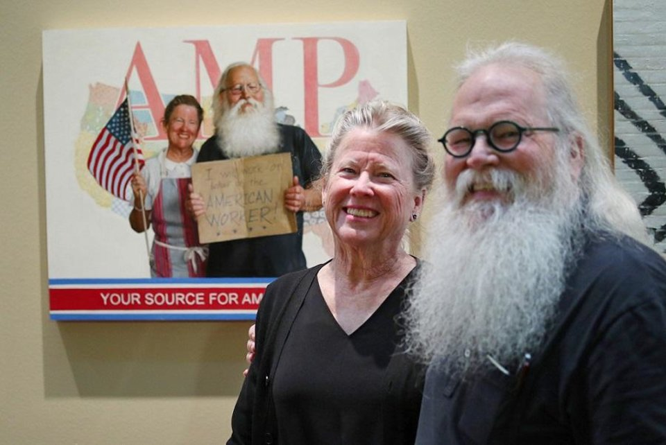 Photo - Mary and John Seward stand in front of their portrait by Georgia-based Oklahoma native Mike Wimmer at the Oklahoma History Center, Thursday, March 21, 2019. An exhibit of Wimmer's portraits of Oklahomans titled