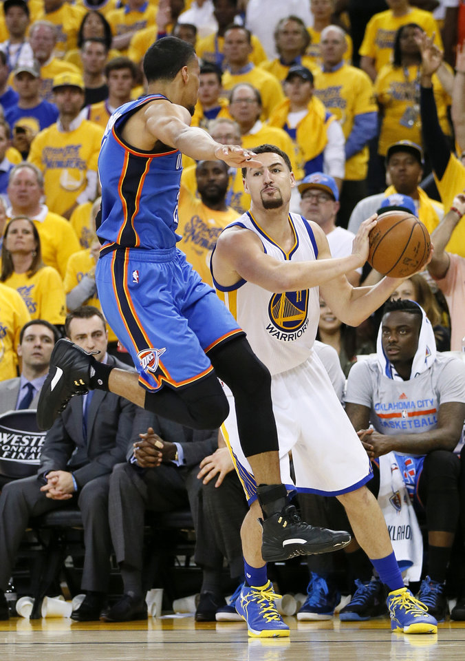 Photo - Oklahoma City's Andre Roberson (21) defends Golden State's Klay Thompson (11) during Game 5 of the Western Conference finals in the NBA playoffs between the Oklahoma City Thunder and the Golden State Warriors at Oracle Arena in Oakland, Calif., Thursday, May 26, 2016. The Warriors won 120-111. Photo by Nate Billings, The Oklahoman