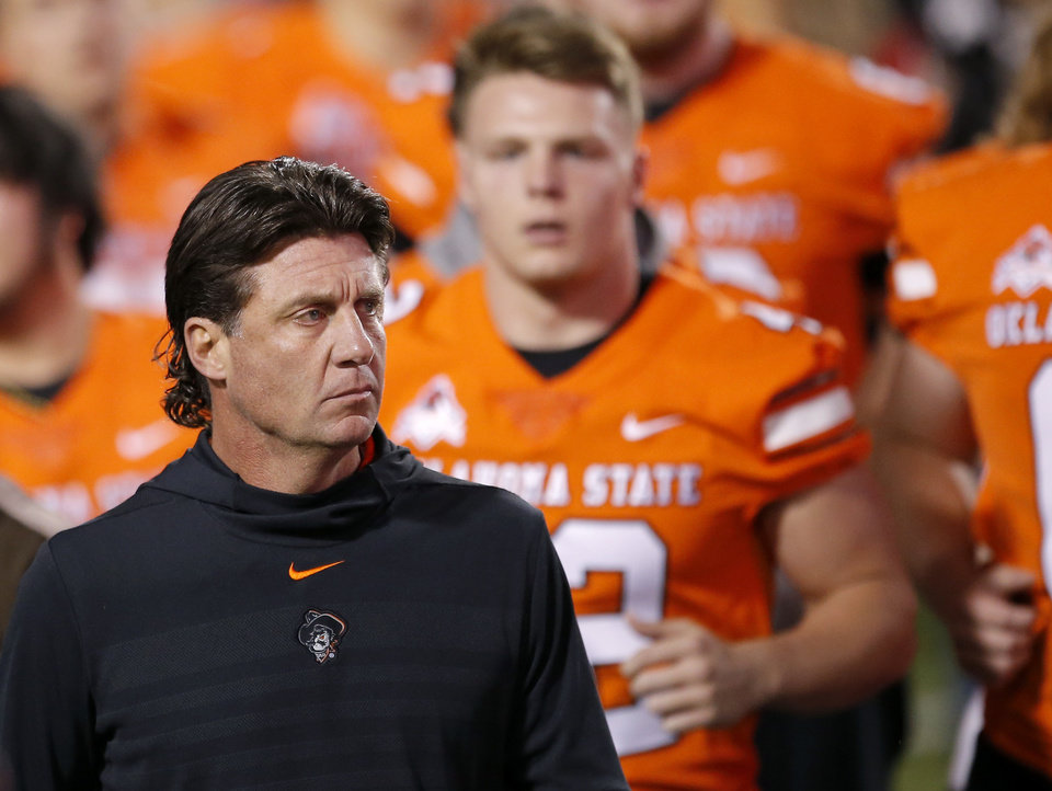 Photo - Oklahoma State head coach Mike Gundy walks onto the field before  a college football game between Oklahoma State (OSU) and University of Texas a at Boone Pickens Stadium in Stillwater, Okla., Saturday, Oct. 27, 2018. Photo by Sarah Phipps, The Oklahoman