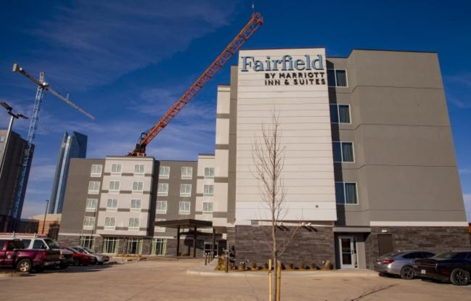 Photo -  The new Fairfield Inn and Suites at 10 SW 4, opened Wednesday. To the north and west, construction is ongoing on the city's future convention center, the Omni Hotel and a parking garage.  [CHRIS LANDSBERGER/THE OKLAHOMAN]
