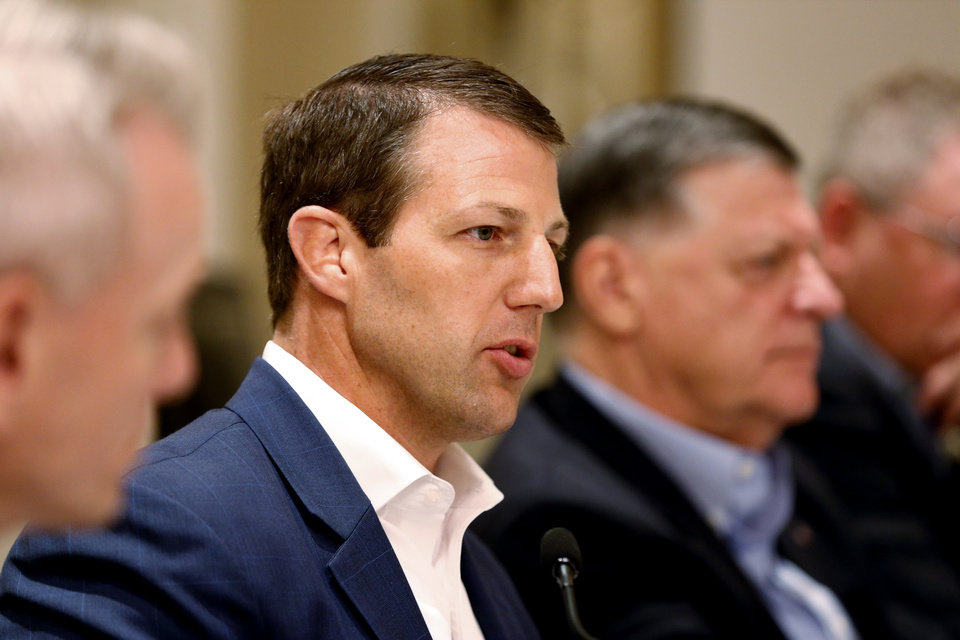 Mullin Barred From Plumbing Company Ads
