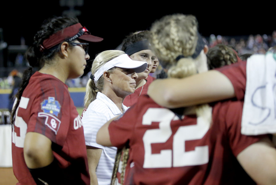Photo - Oklahoma head coach Patty Gasso huddle with her team following the second NCAA softball game in the championship series of the Women's College World Series between Oklahoma and UCLA at USA Softball Hall of Fame Stadium in Oklahoma City, Tuesday, June 4, 2019. [Sarah Phipps/The Oklahoman]