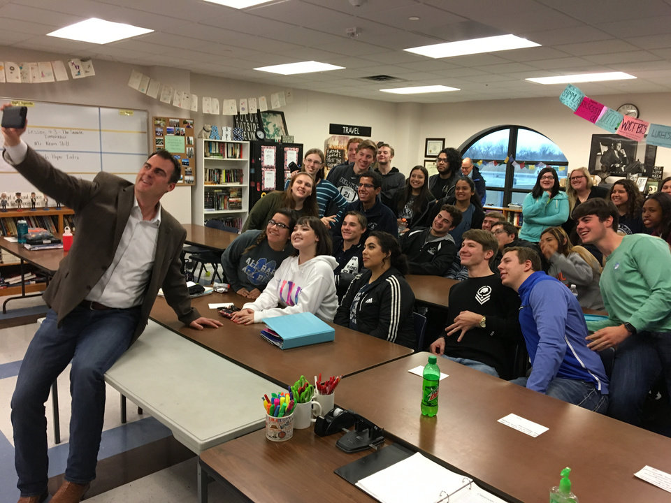 Photo - Gov.-elect Kevin Stitt poses for a selfie with students at Altus High School while campaigning last year. [The Oklahoman archives]