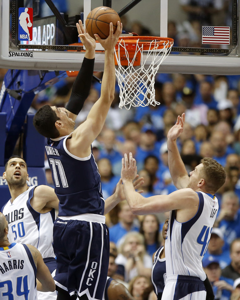 Photo - Oklahoma City's Enes Kanter (11) goes to the basket between Dallas' Salah Mejri (50) and David Lee (42) during Game 3 of the first round series between the Oklahoma City Thunder and the Dallas Mavericks in the NBA playoffs at American Airlines Center in Dallas, Thursday, April 21, 2016. The Thunder won 131-102. Photo by Bryan Terry, The Oklahoman