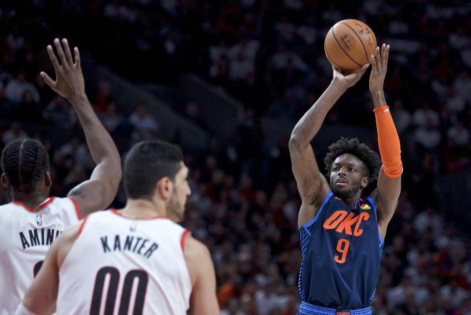 Photo - Oklahoma City Thunder forward Jerami Grant, right, shoots over Portland Trail Blazers forward Al-Farouq Aminu during the first half of Game 5 of an NBA basketball first-round playoff series, Tuesday, April 23, 2019, in Portland, Ore. (AP Photo/Craig Mitchelldyer)