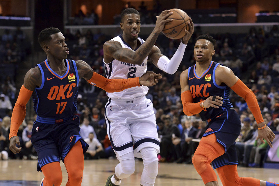 Photo - Memphis Grizzlies guard Delon Wright (2) drives between Oklahoma City Thunder guards Dennis Schroeder (17) and Russell Westbrook during the first half of an NBA basketball game Monday, March 25, 2019, in Memphis, Tenn. (AP Photo/Brandon Dill)