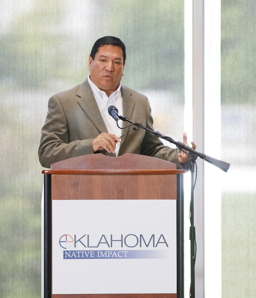 Photo - Cheyenne and Arapaho Tribes Gov. Reggie Wassana speaks at the Oklahoma Tribal Finance Consortium, alongside tribal leaders, release the results of a study gauging the economic impact of the tribes on the state, Thursday, July 18, 2019. [Doug Hoke/The Oklahoman]