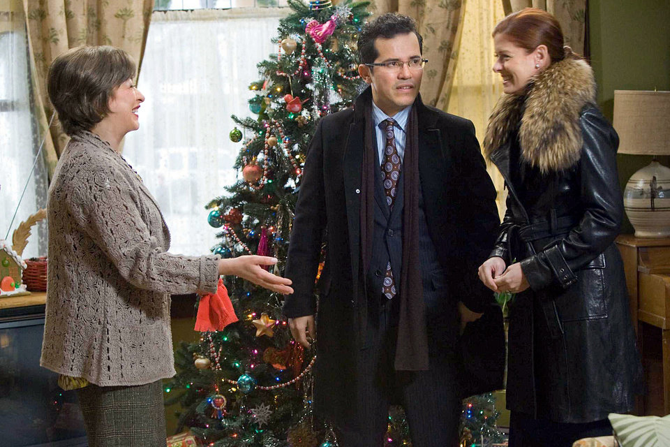 "Photo - Elizabeth Pena, John Leguizamo and Debra Messing star in ""Nothing Like the Holidays."" OVERTURE FILMS PHOTO"