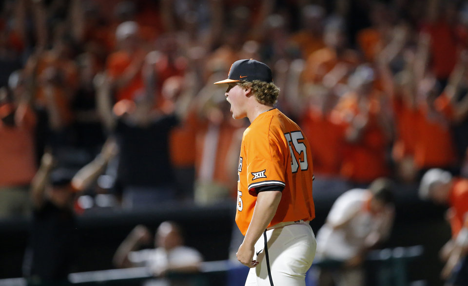 Photo - Oklahoma State's Peyton Battenfield (55) celebrates the Cowboys' win over UConn during the Oklahoma City Regional NCAA baseball game at Chickasaw Bricktown Ballpark in Oklahoma City,  Monday, June 3, 2019. OSU won 3-1. [Sarah Phipps/The Oklahoman]