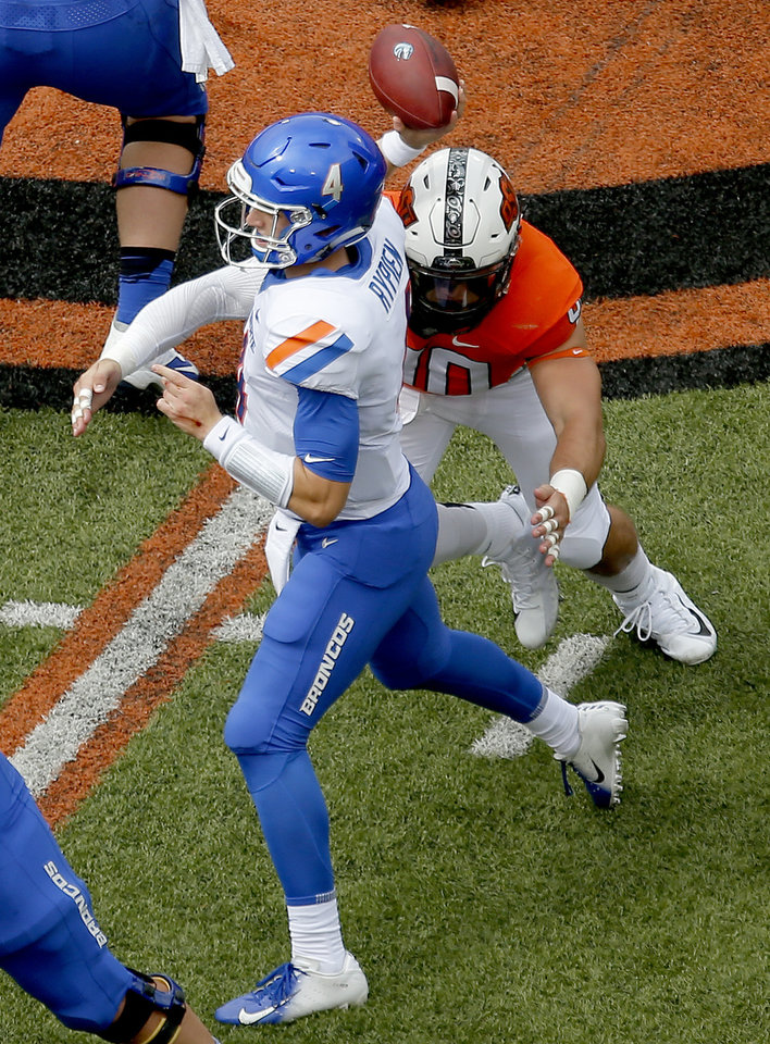 Photo - Oklahoma State's Brock Martin (40) pressures Boise State's Brett Rypien (4) as he throws in the first quarter during a college football game between the Oklahoma State Cowboys (OSU) and the Boise State Broncos at Boone Pickens Stadium in Stillwater, Okla., Saturday, Sept. 15, 2018. OSU won 44-21. Photo by Sarah Phipps, The Oklahoman