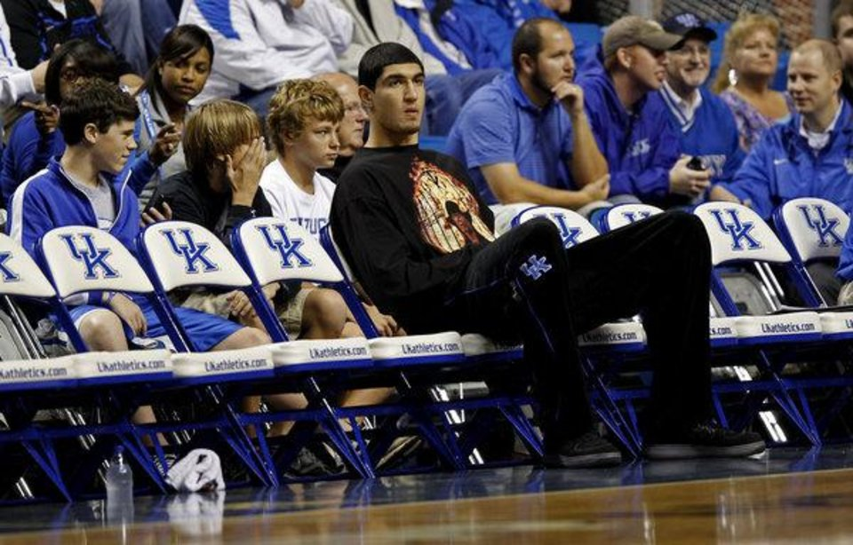 Photo - Enes Kanter sits on the bench during a University of Kentucky basketball game in 2011. Before ever playing a game in Lexington, Kanter was ruled permanently ineligible for receiving excess benefits from Turkish basketball club Fenerbahce before he came to UK. Photo/Google