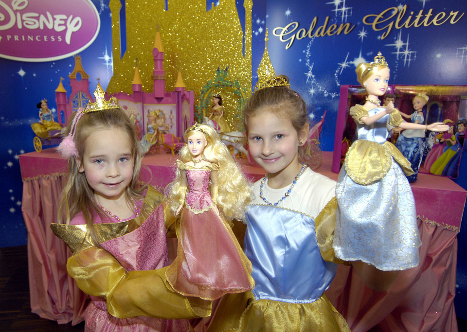 Photo - Kristin, right, and Marie pose with their Disney Princess dolls on a booth of the toy producer Simba Toys, during the press preview day of the 58th International Toy Fair Jan. 31, 2007 in Nuremberg, southern Germany. (AP Photo/Uwe Lein)  UWE LEIN - AP