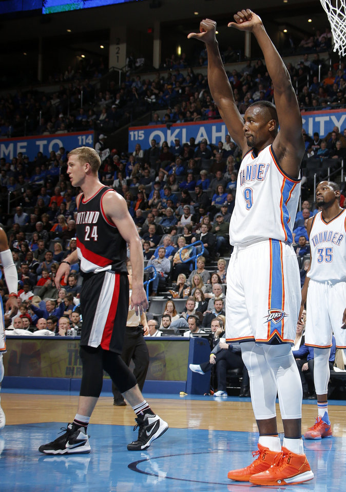 Photo - Oklahoma City's Serge Ibaka (9) celebrates a block beside Portland's Mason Plumlee (24) during an NBA basketball game between the Oklahoma City Thunder and the Portland Trail Blazers at Chesapeake Energy Arena in Oklahoma City, Wednesday, Dec. 16, 2015. Oklahoma City won 106-90.  Photo by Bryan Terry, The Oklahoman